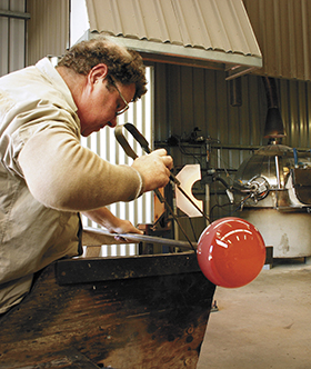 Student working in ECU glass studio.  Image: Mike Gray