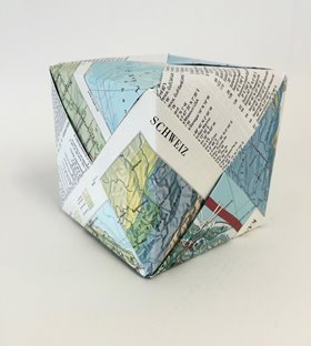 Jennifer Cochrane, Swiss World Atlas Cube, 2016. Dock Under. Paper from Swiss World Atlas books. 10x10x10cm. Image courtesy of the artist.