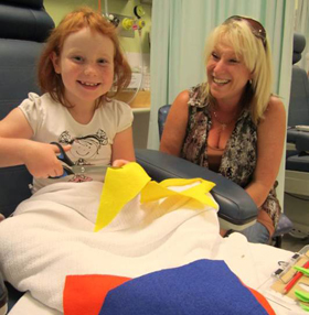 Patient Jemma and her mum, creating artwork during a bedside visit. Image: Mark Zimmerman