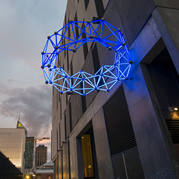 Joshua Webb, Blue Sun, 2017. Anodized Aluminum, polycarbonate, PMMA, LEDS, Stainless steel & brass. Image courtesy the artist.